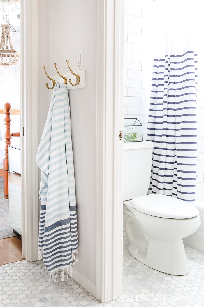 navy-and-brass-bathroom-with-white-subway-tile-1